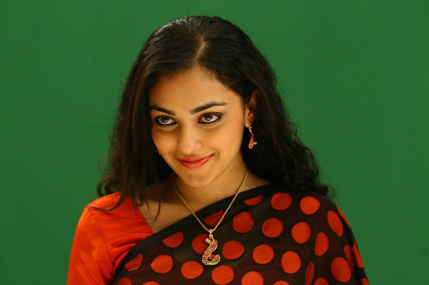 Nithya menen red saree fotos