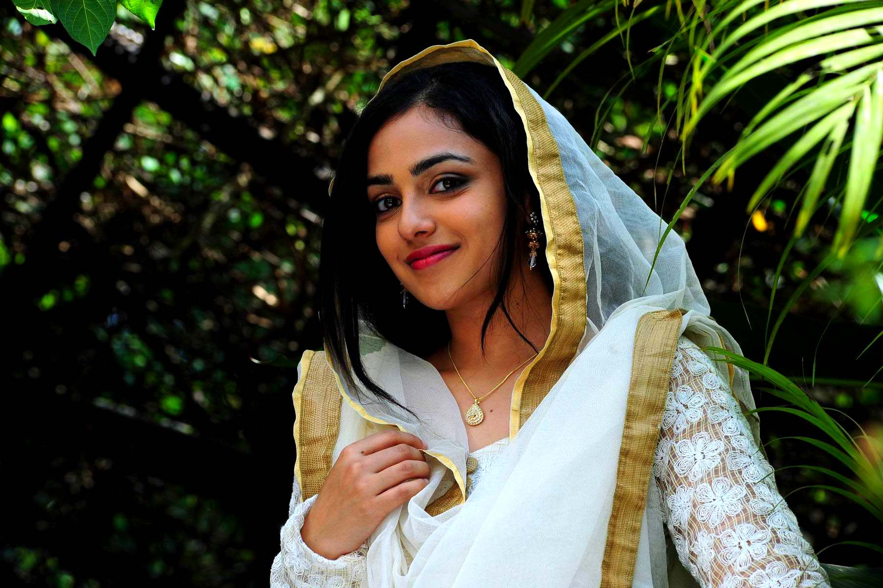 Nithya menen white chudithar photos