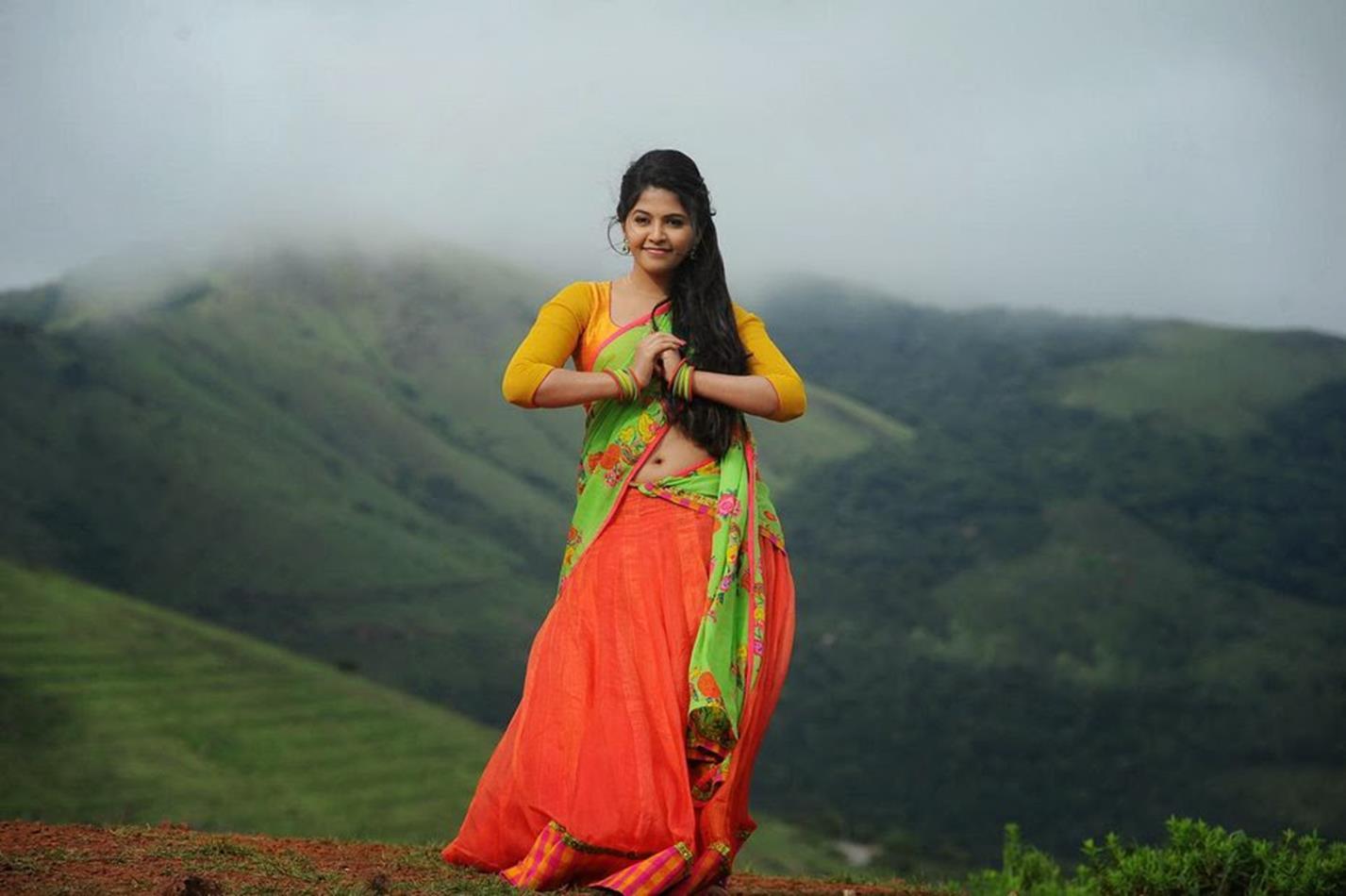 Anjali green half saree hot photos