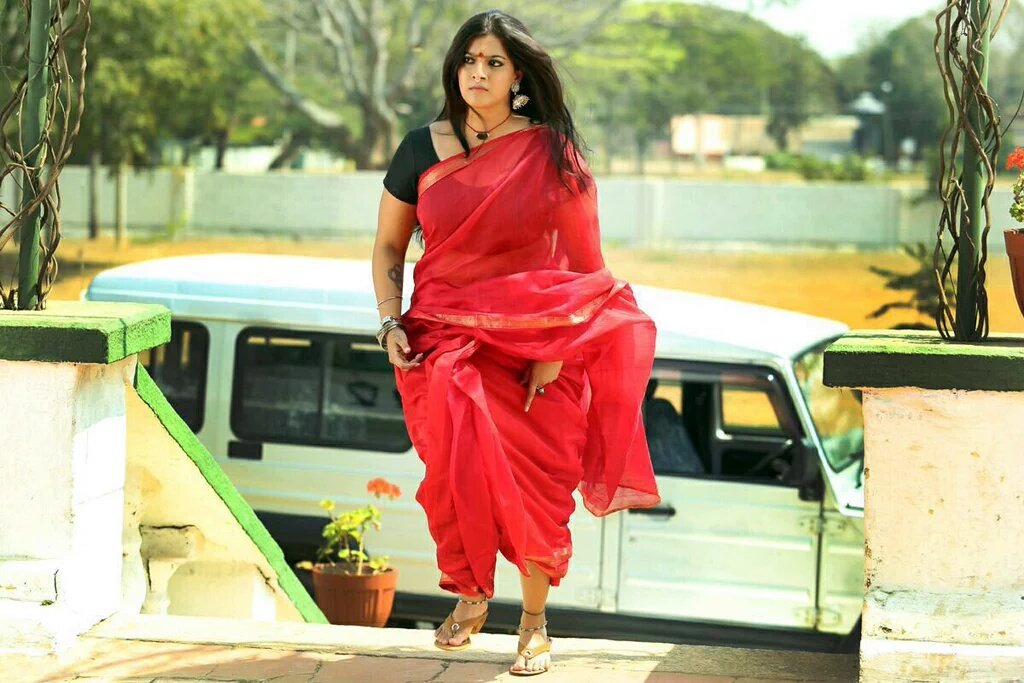 Kasaba movie actress varalakshmi red saree photos