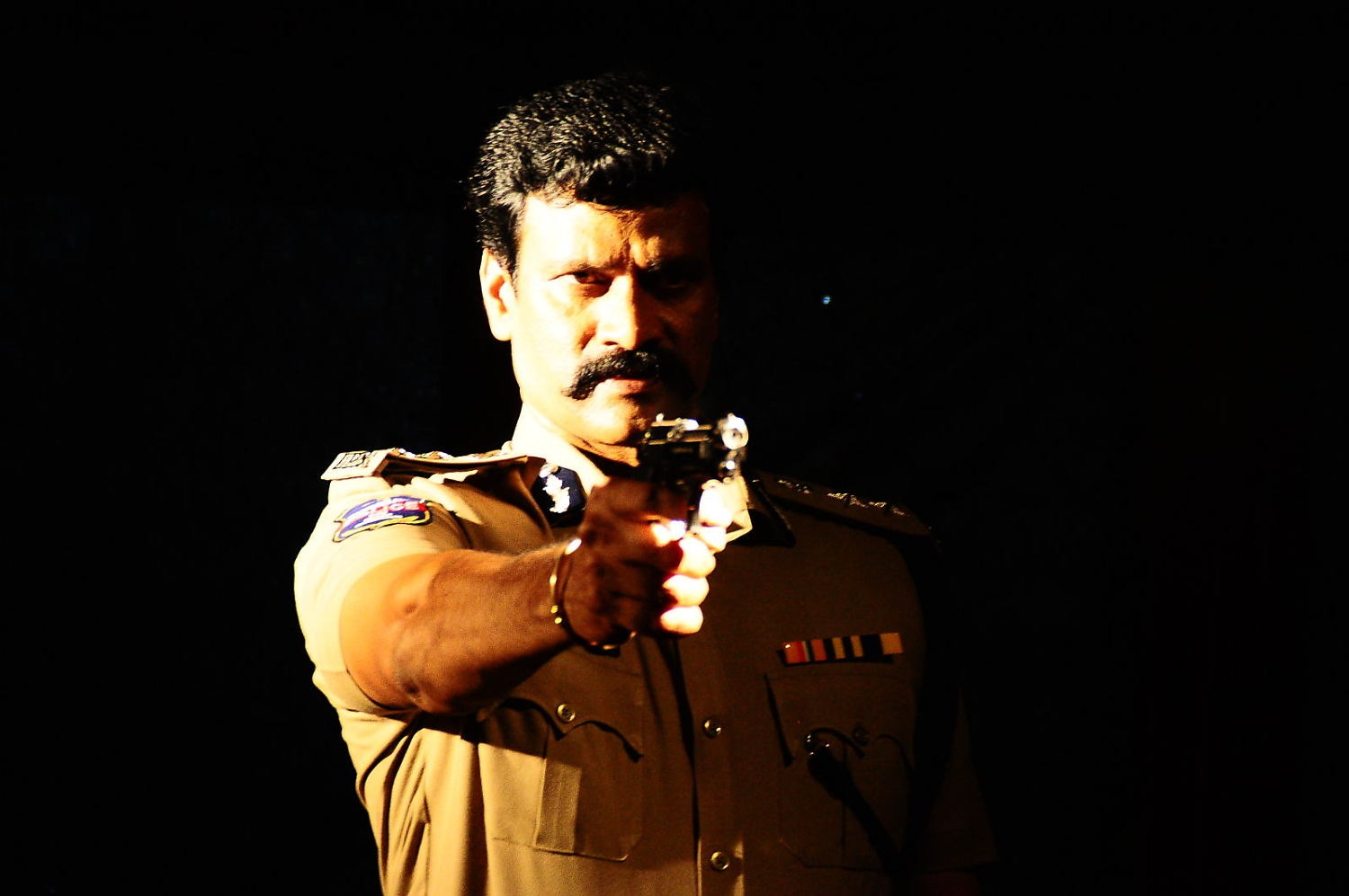 Rudra IPS telugu movie raj krishna police dress stills