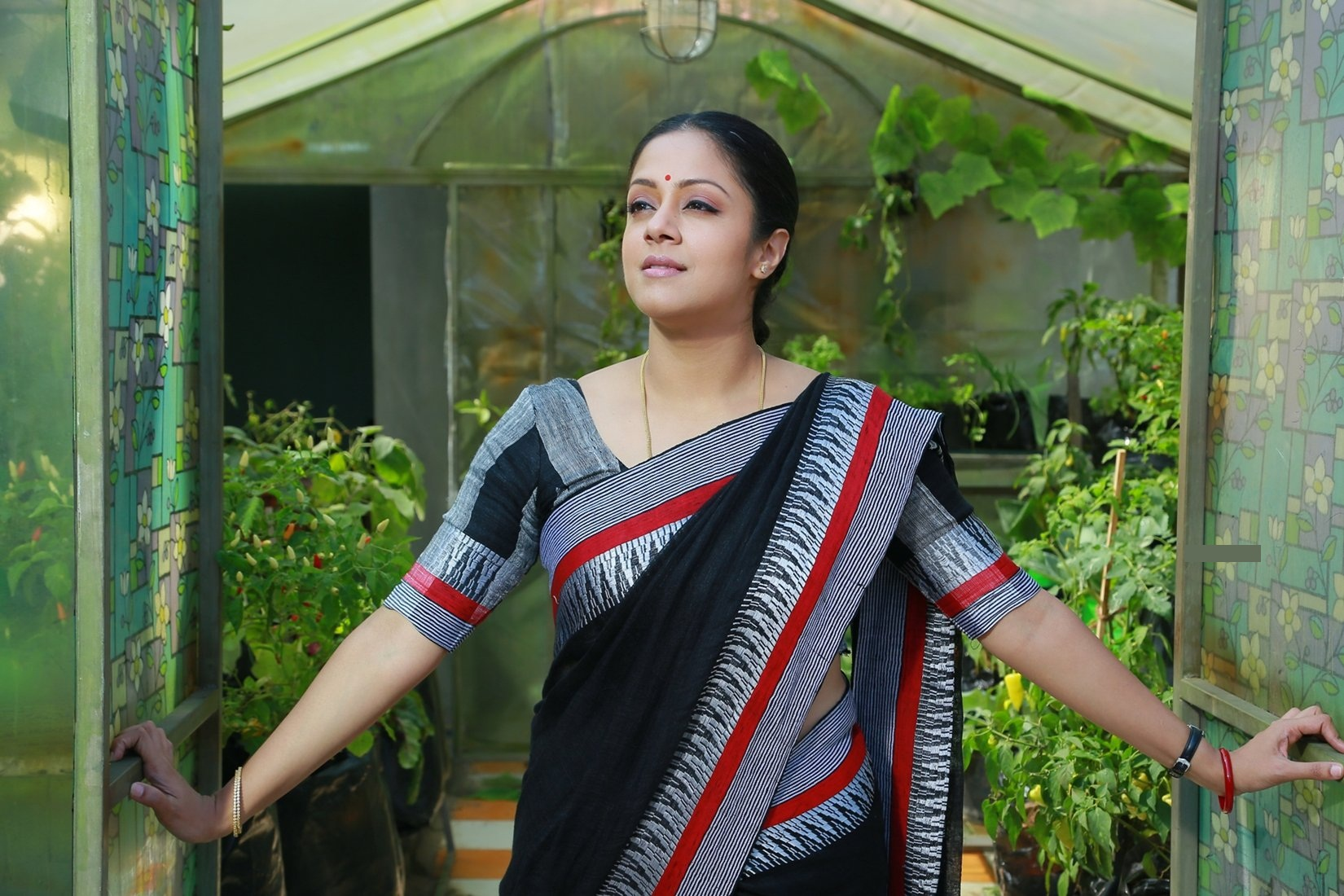 Jyothika suriya black saree photos