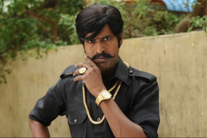 Kaththi sandai comedy actor soori photos