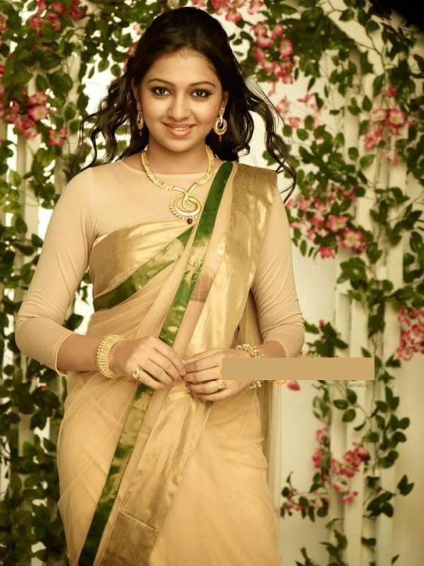 Lakshmi menon gold saree photos