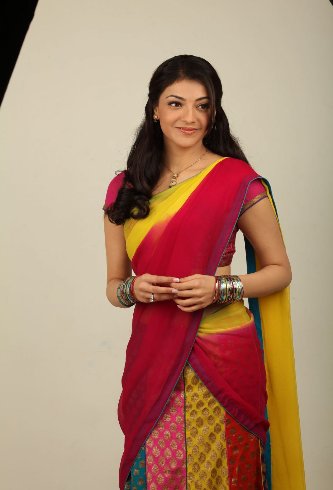 Kajal agarwal red and yellow saree pictures