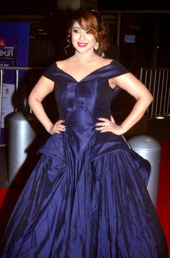 Payal ghosh blue dress smile pose stills