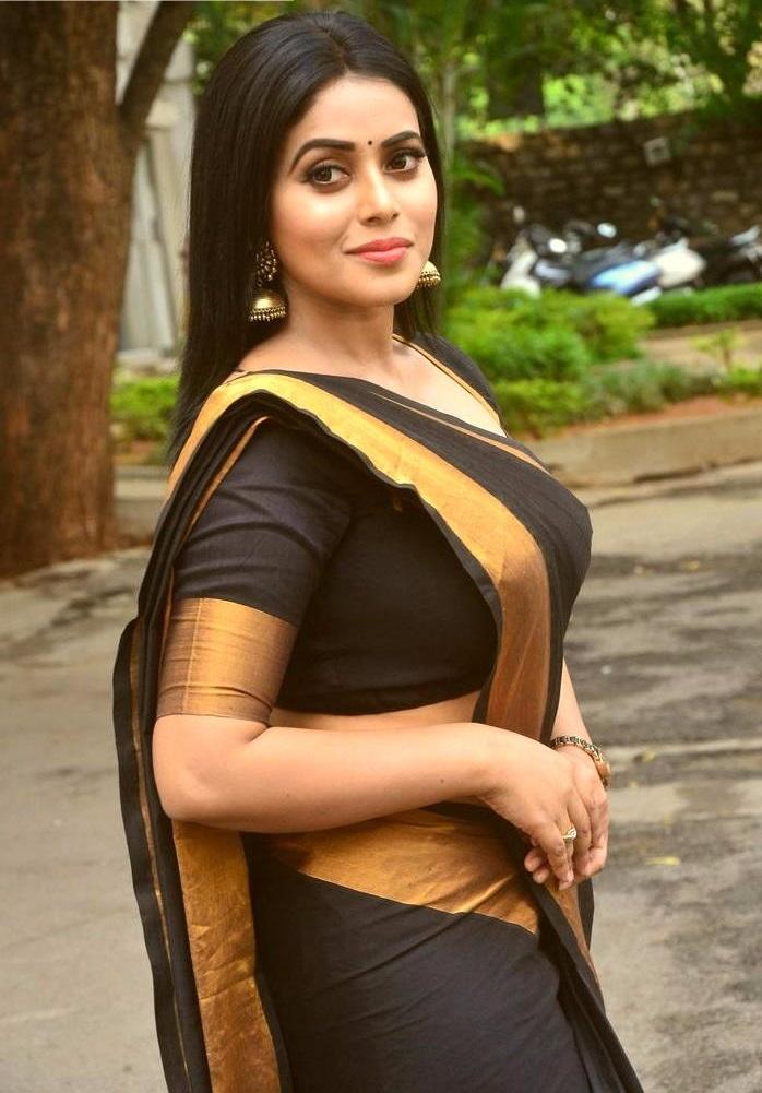 Poorna black saree photoshoot stills