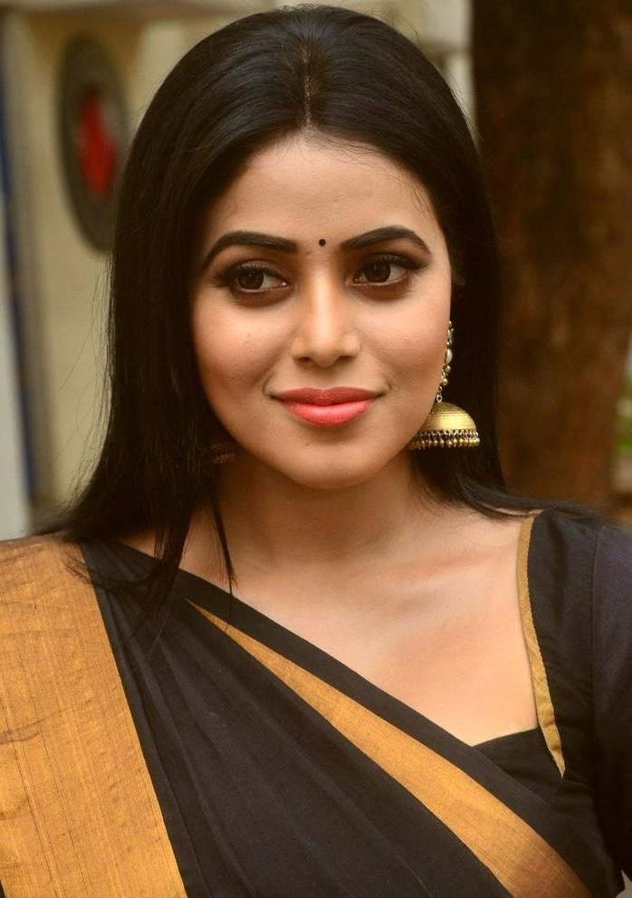 Poorna black saree smile pose cute stills