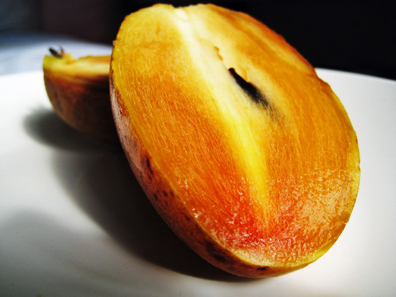 Sapodilla half fruits photos