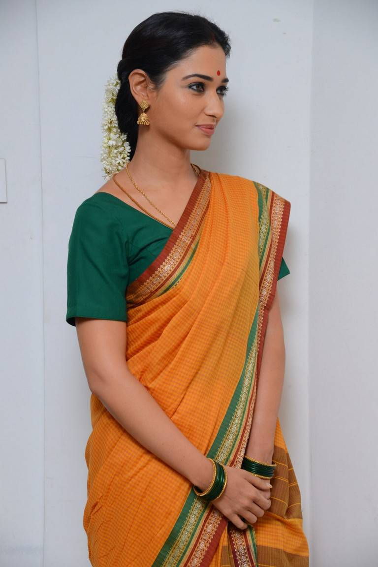 Tamanna bhatia dark yellow saree pictures