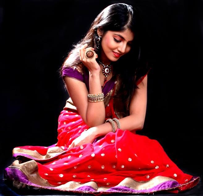Anaswara kumar red saree gallery