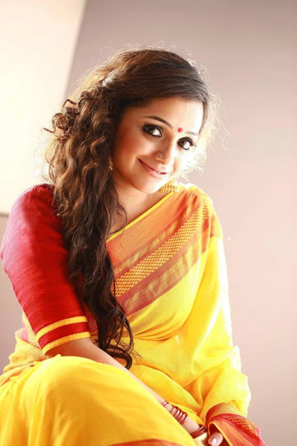Ann augustine yellow saree pictures