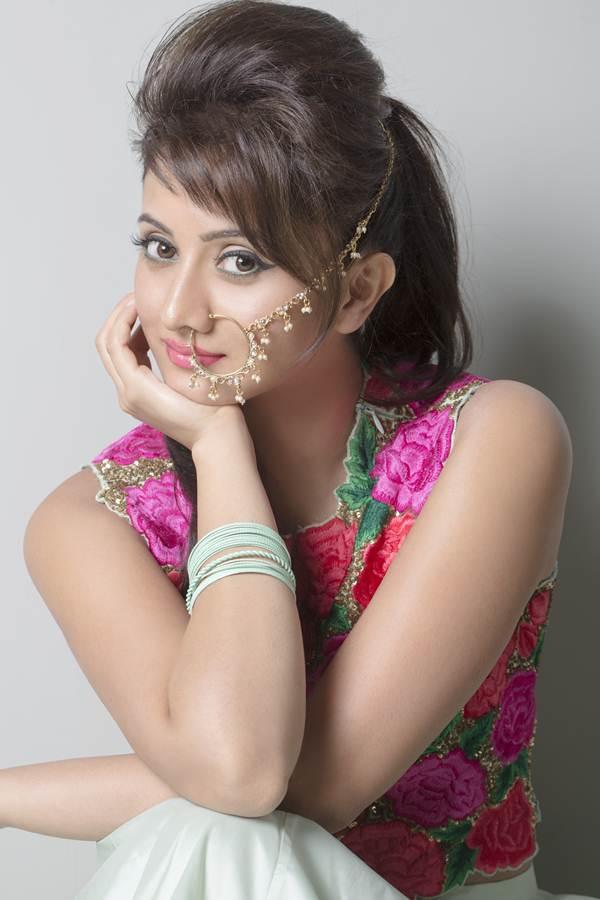 Harshika poonacha cute hairstyle photos