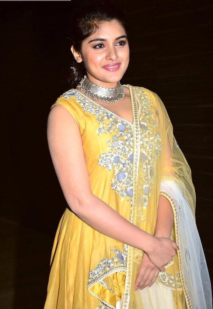 Nivetha thomas yellow dress hd pictures