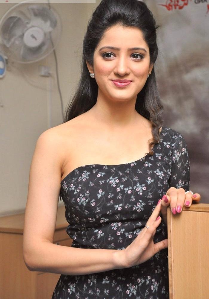 Richa panai black dress smile pose slide show