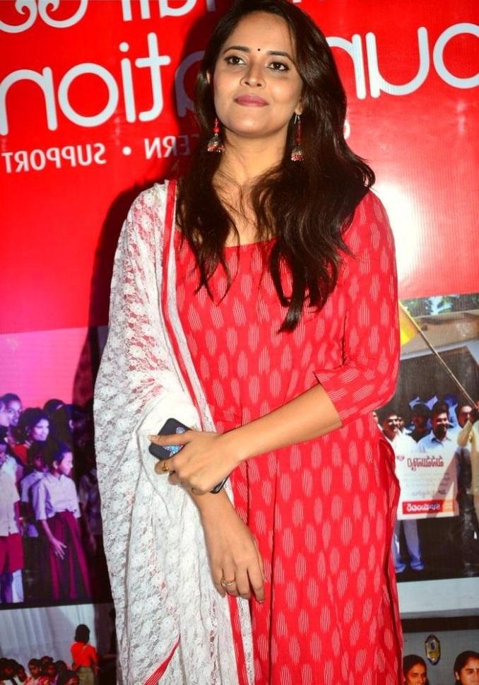 Anasuya bharadwaj red dress smile pose image