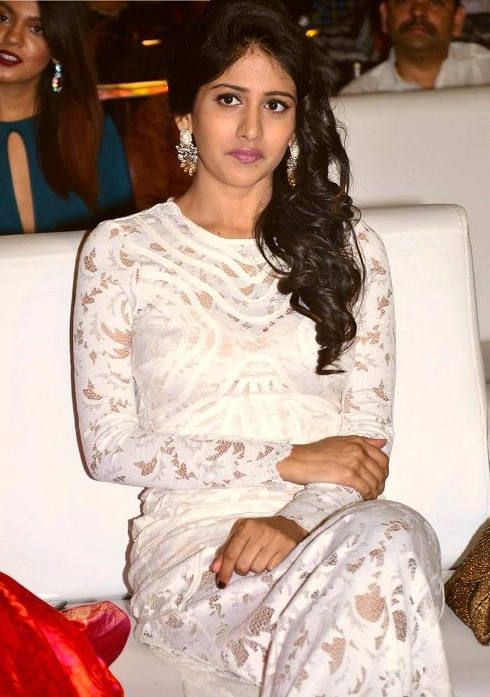 Chandini chowdary white dress smile pose wallpaper
