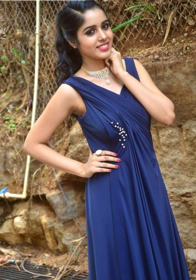 Keerthi blue dress press meet image
