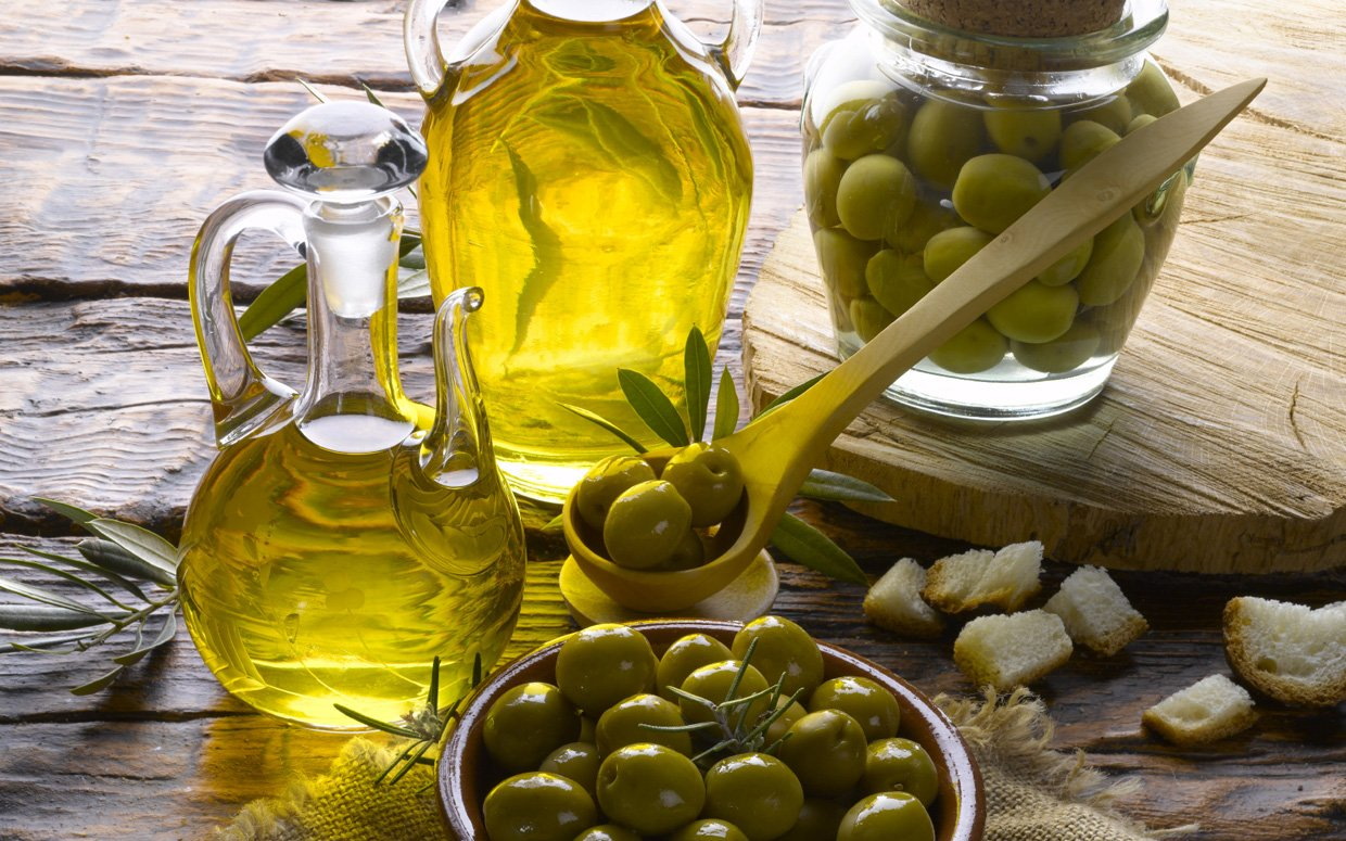 Olive fruits and olive oil photos
