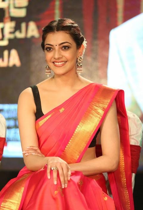 Kajal agarwal red saree smile pose pictures