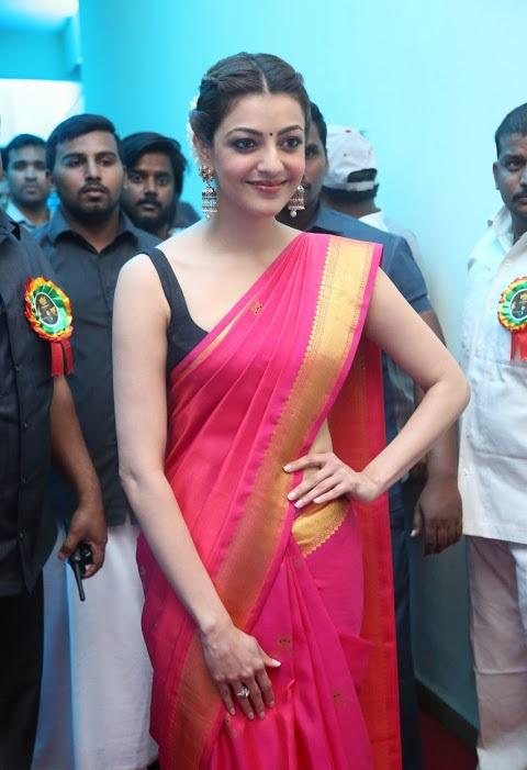 Kajal agarwal red saree wide smile pose photos