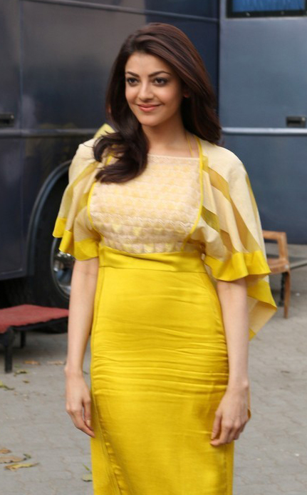 Kajal agarwal yellow dress beautiful naval stills