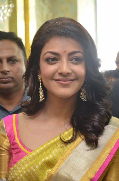 Kajal agarwal yellow saree cute face stills
