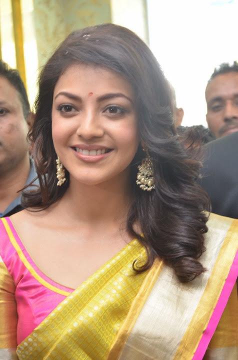 Kajal agarwal yellow saree smile pose wallpaper