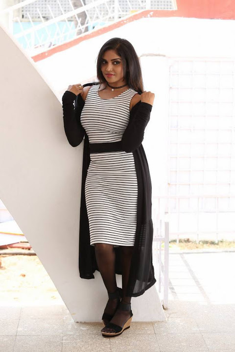 Karunya chowdary black and white dress smile pose pics