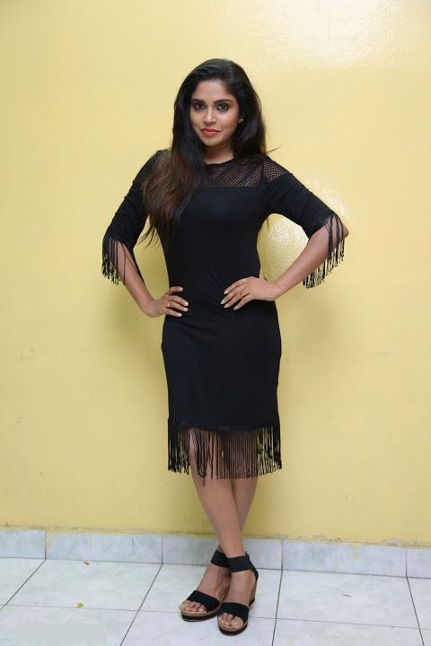 Karunya chowdary black dress smile pose photos