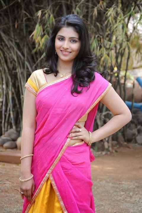 Kruthika jayakumar pink half saree smile pose gallery