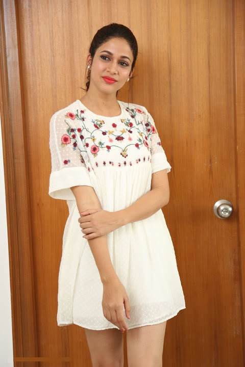 Lavanya tripathi white dress smile pose gallery