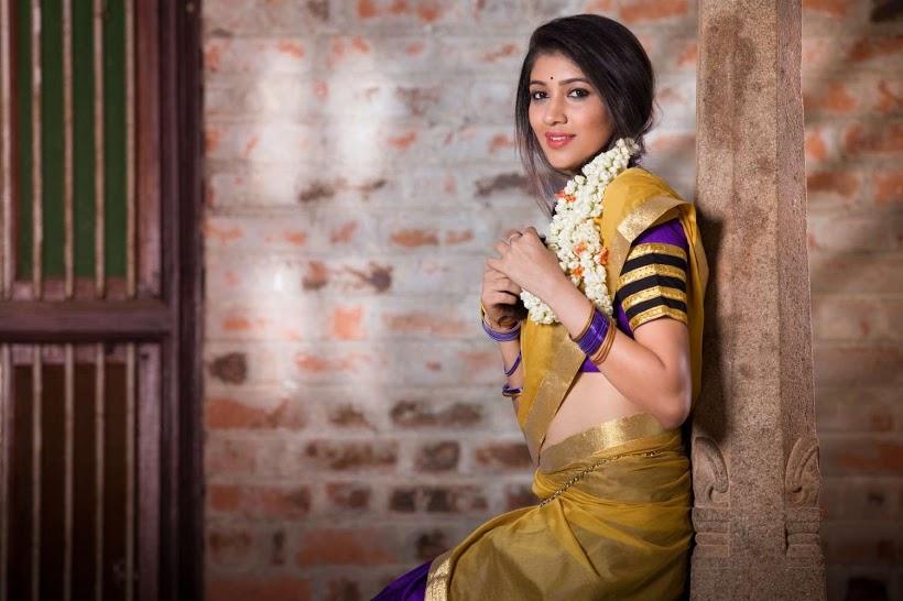 Akhila kishore yellow color saree photos
