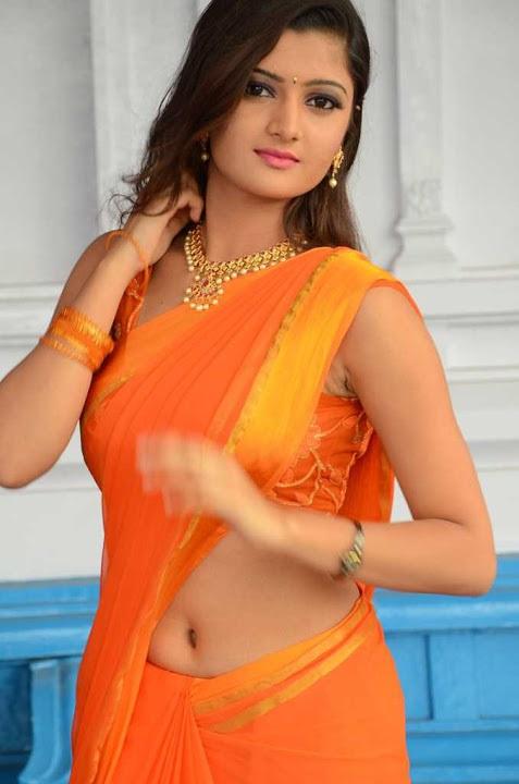 Akkshita orange color saree glamorous pics