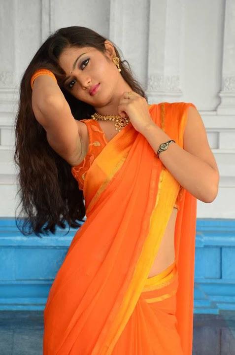 Akkshita orange color saree press meet gallery