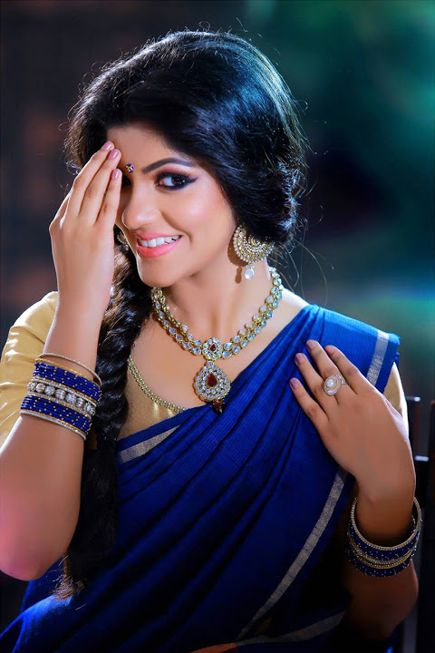 Aparna balamurali half saree smile pose wallpaper