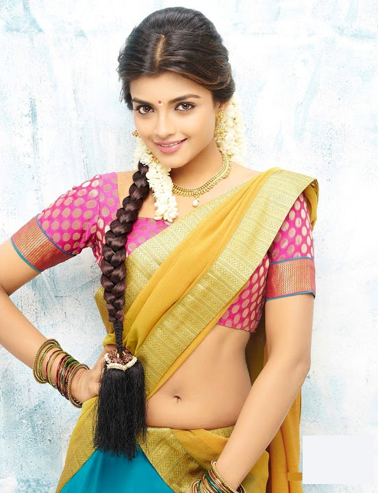 Ashna zaveri yellow half saree image