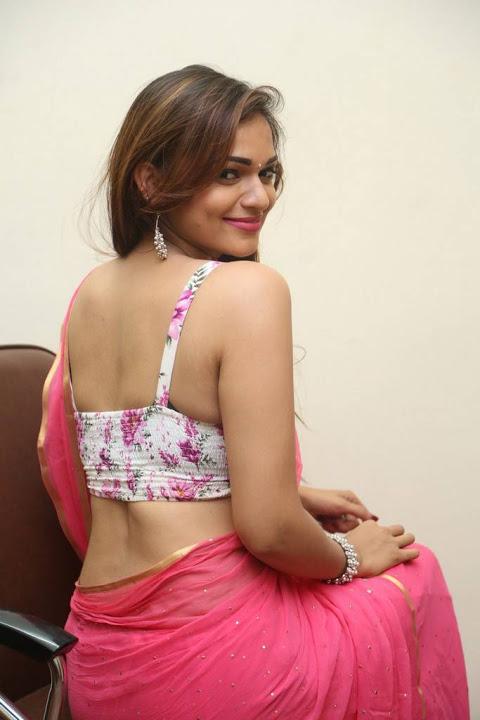 Ashwini pink saree backless wide slide show