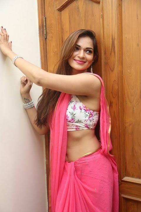 Ashwini pink saree press meet fotos