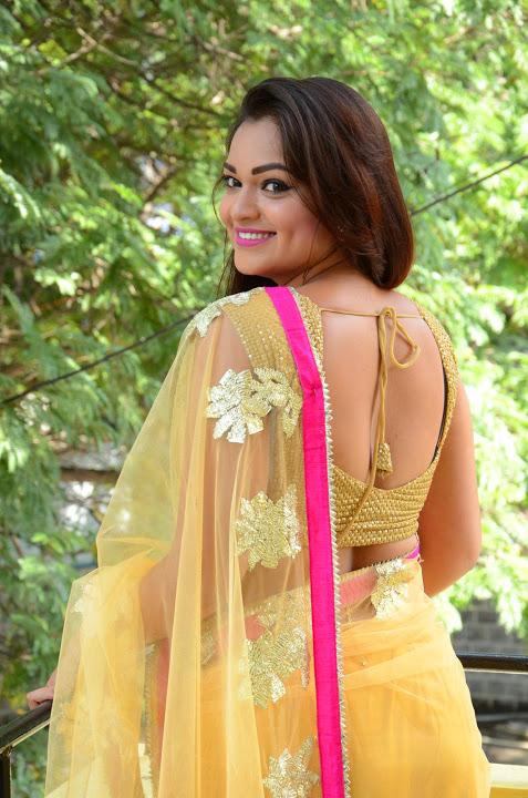 Ashwini yellow saree backless pictures