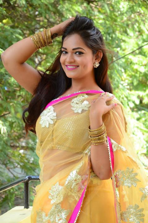 Ashwini yellow saree exclusive image