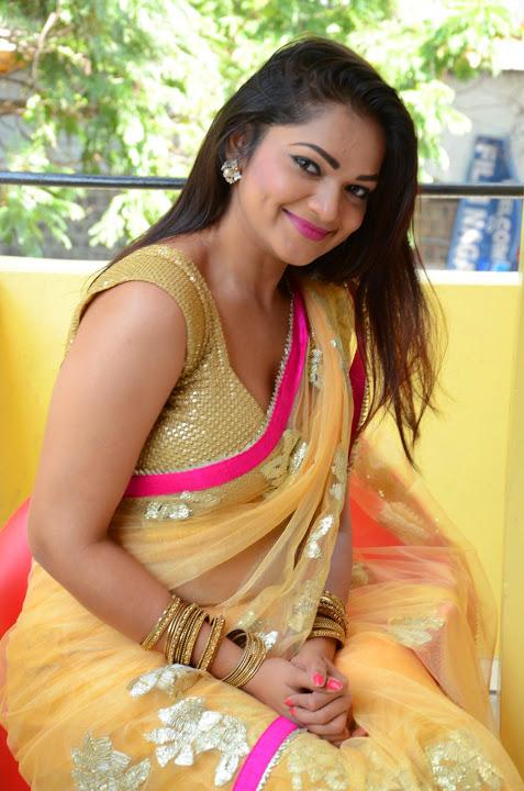 Ashwini yellow saree modeling fotos