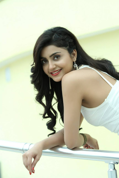 Avantika mishra white dress smile pose photos