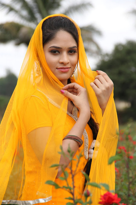 Sanyathara yellow dress fashion photos