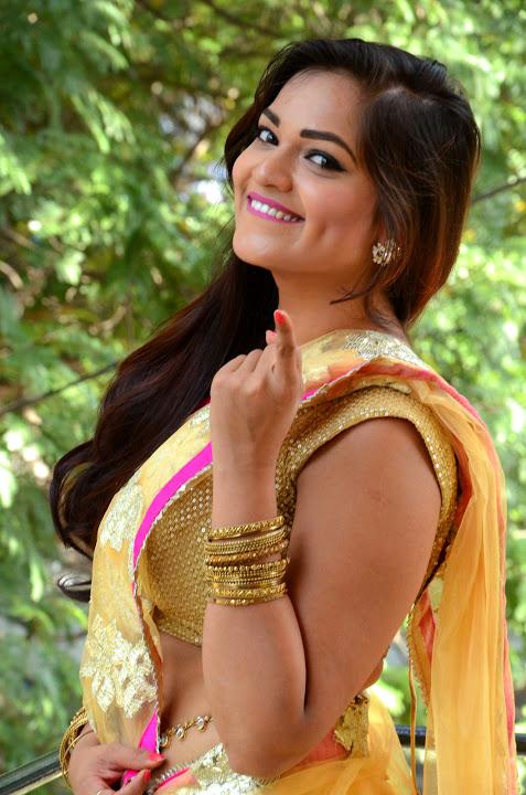 Tamil actress ashwini yellow saree fashion stills