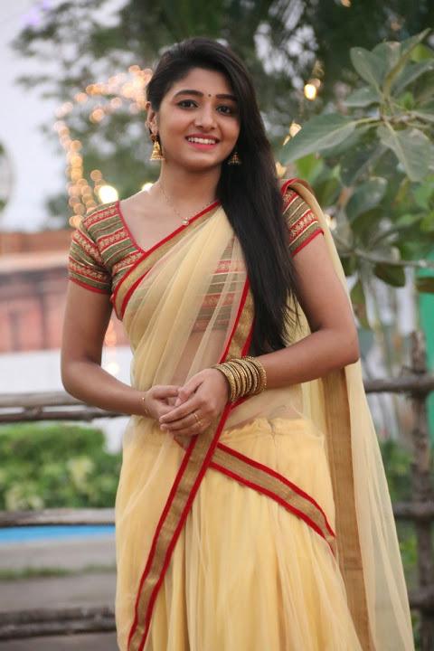 Adithi menon smile pose yellow gallery
