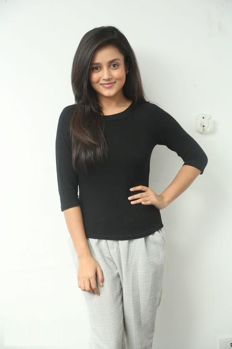 Mishti chakraborty black dress smile pose gallery