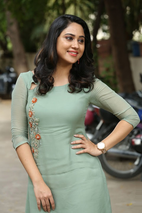 Miya george green dress smile pose gallery