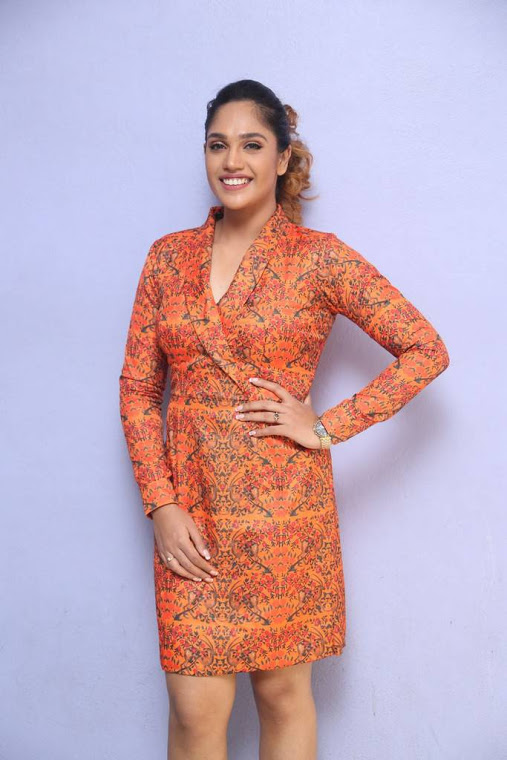Mumtaz sorcar orange coor dress interview photos