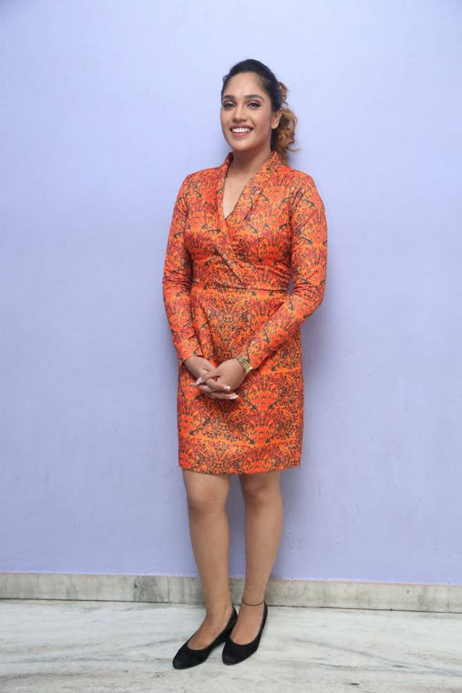 Mumtaz sorcar orange coor dress press meet stills